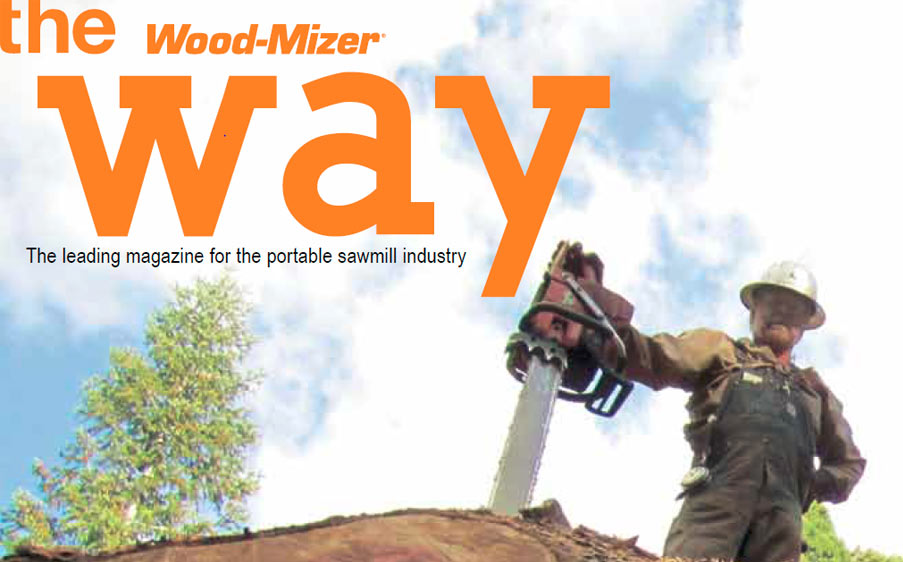 an image of a lumberjack holding his chainsaw, wearing a white hard hat, and the words next to him on the cover read 'The Wood-Mizer Way'