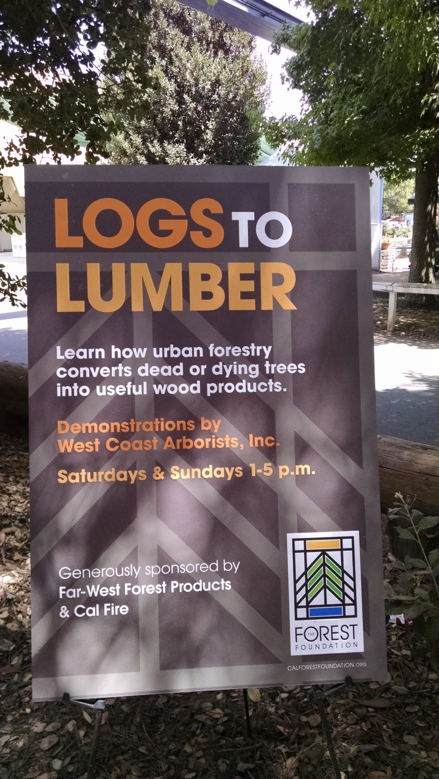 Logs to Lumber sign with Far West and WCA at the CA State Fair 2015