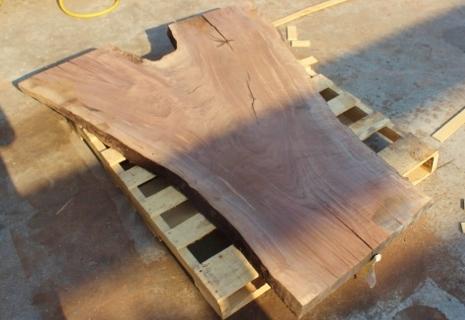 claro walnut slab with crotch. Beautiful dark and like brown colors nice grain pattern. Some cracks.